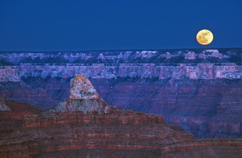 Moon over canyon