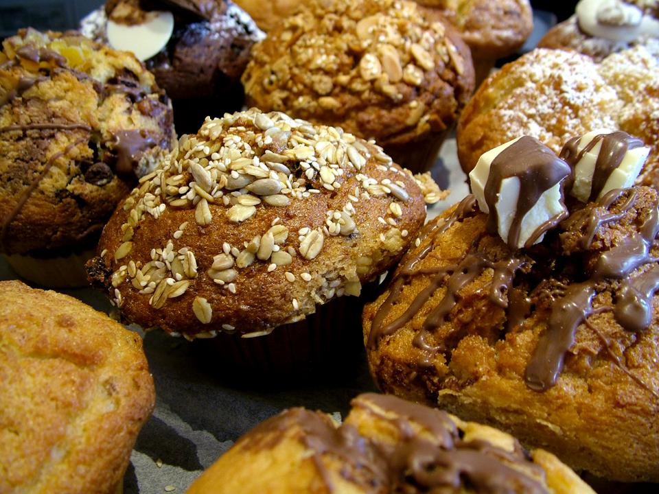 A platter of muffins and baked goods.