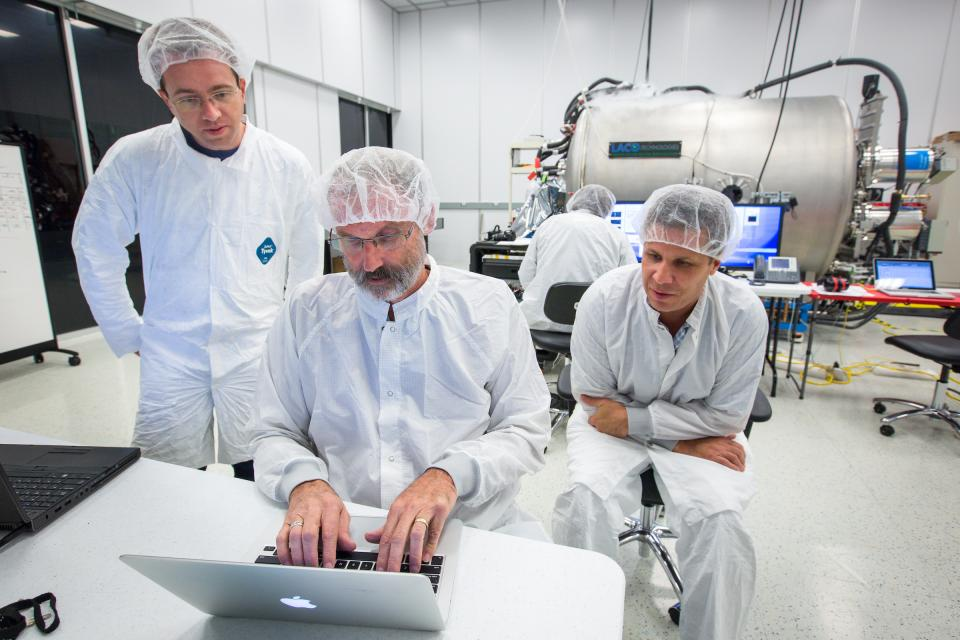 Scientists work in a clean lab