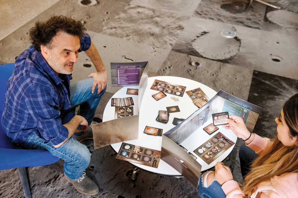 Two people play a Mars card game