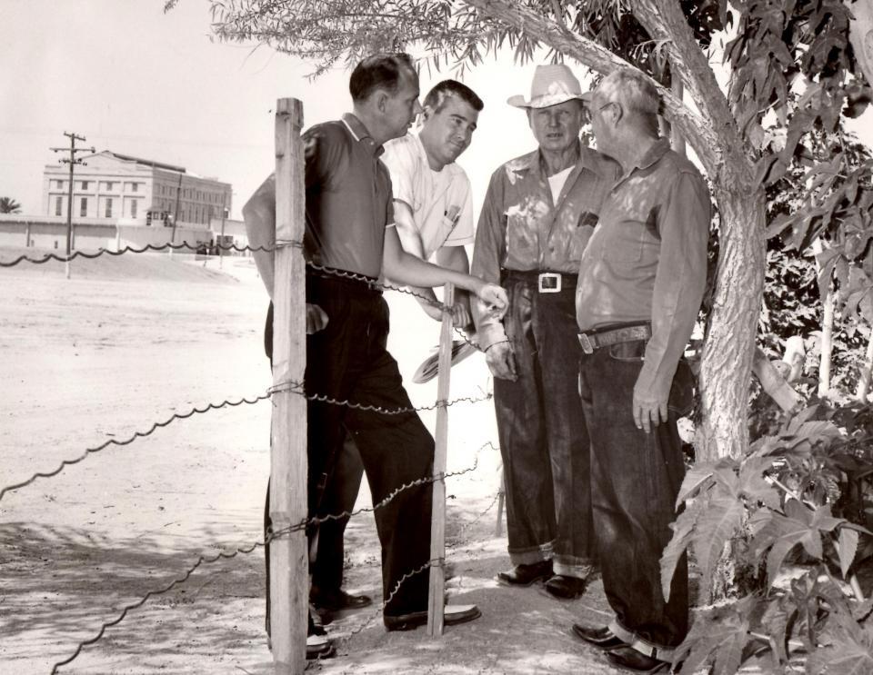 four men talking