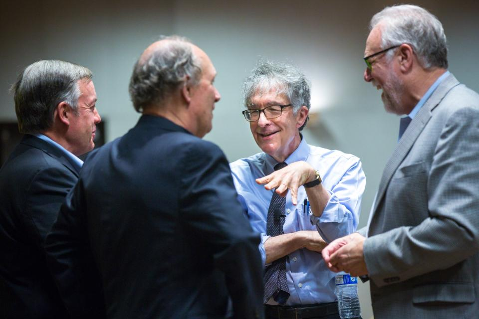Harvard professor Howard Gardner speaks with ASU President Michael Crow and others.