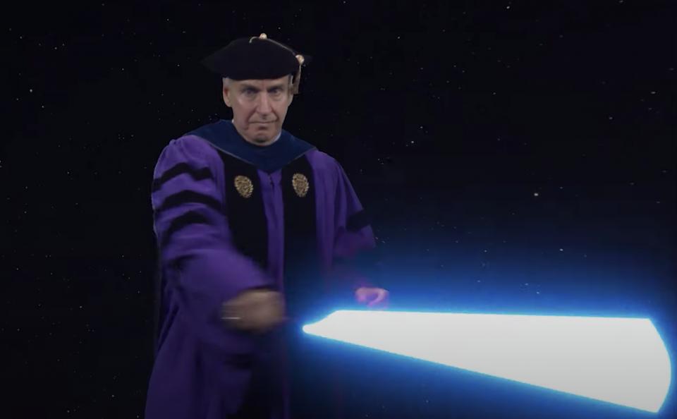 Vice Dean James Collofello yields a lightsaber