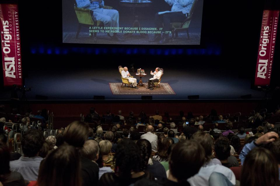Animal-rights philosopher Peter Singer and theoretical physicist Lawrence Krauss on stage