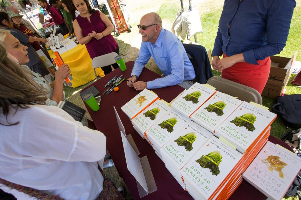 Michael Pollan signs books at the School of Sustainability picnic.