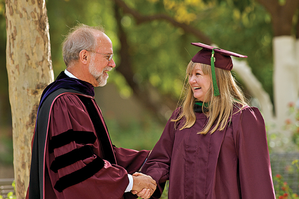 Dr. Charles Redman welcomes the first School of Sustainability graduate.
