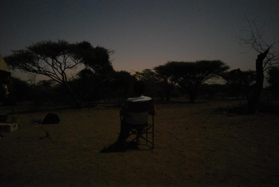 photo of Smail watching the sunrise in Ledi-Geraru