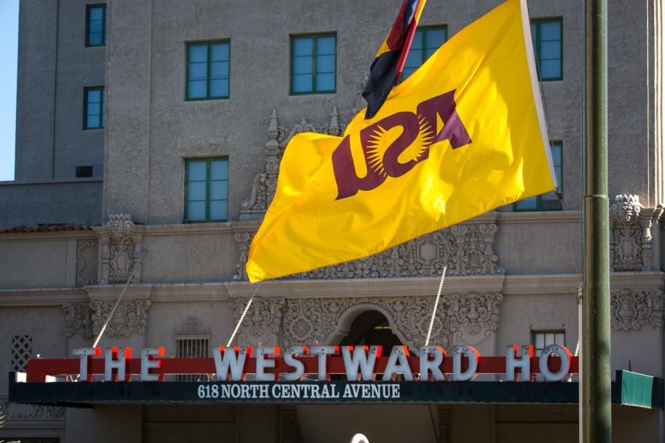 An ASU flag flies across the street from the Westward Ho