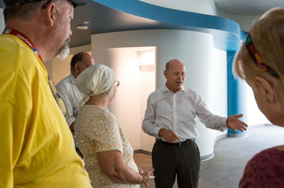A group tours the renovated ground floor of the Westward Ho.