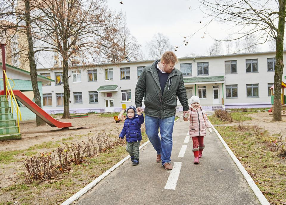 ASU McCain scholar Yaroslav Bekish walks with his children