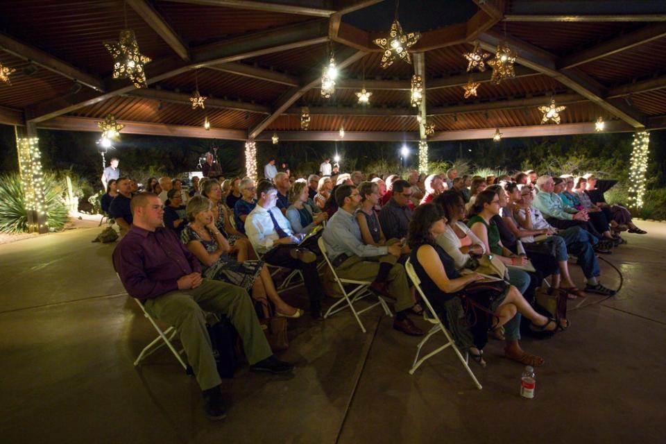 A Zocalo Public Square audience sits under a large gazebo at Desert Botanical Garden.