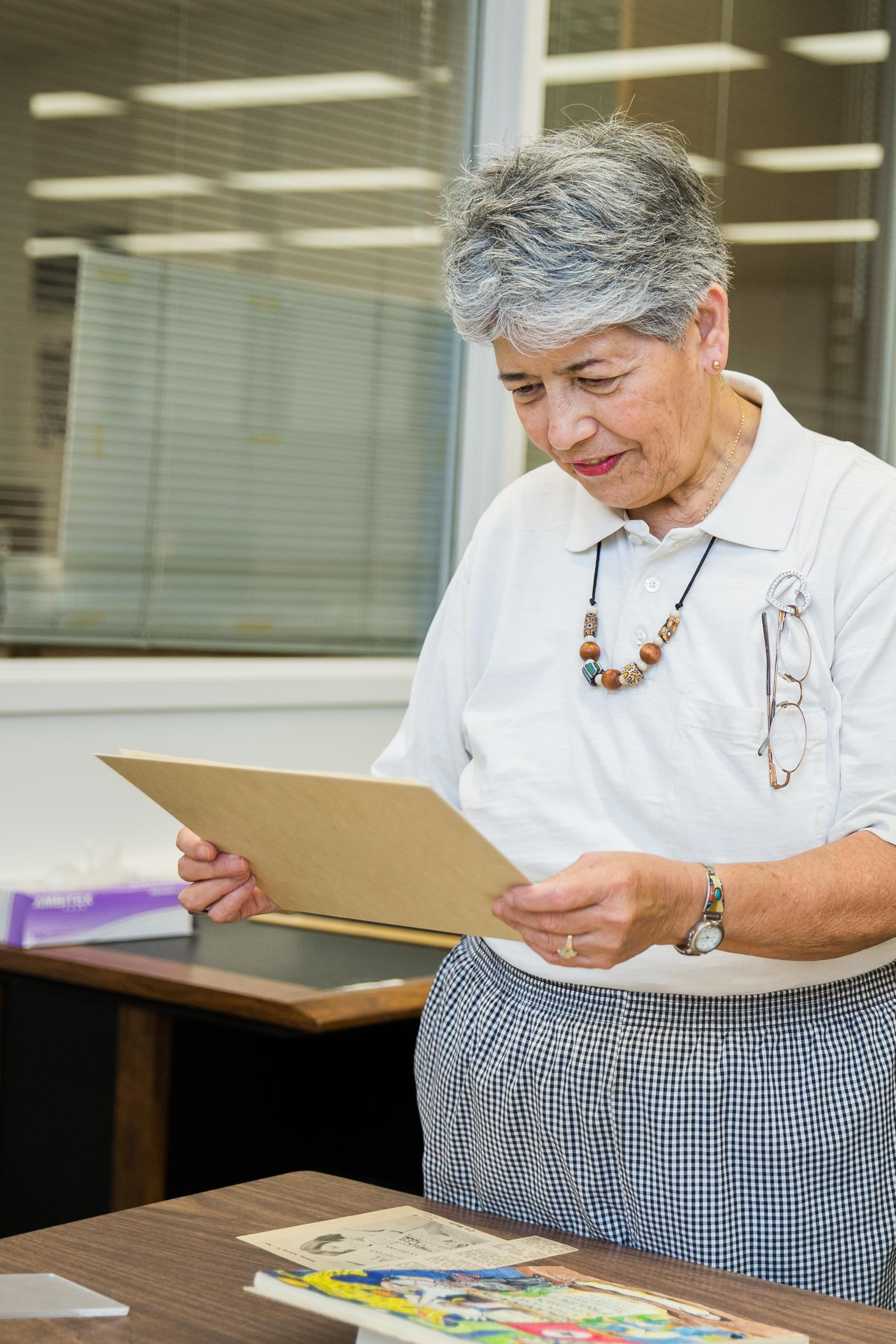 A woman looks at archival items at the library