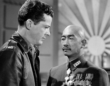 A white man and an Asian man in a scene from the 1944 movie The Purple Heart