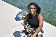 woman holding tuba