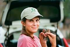 ASU student Allyson Shaw holds finches