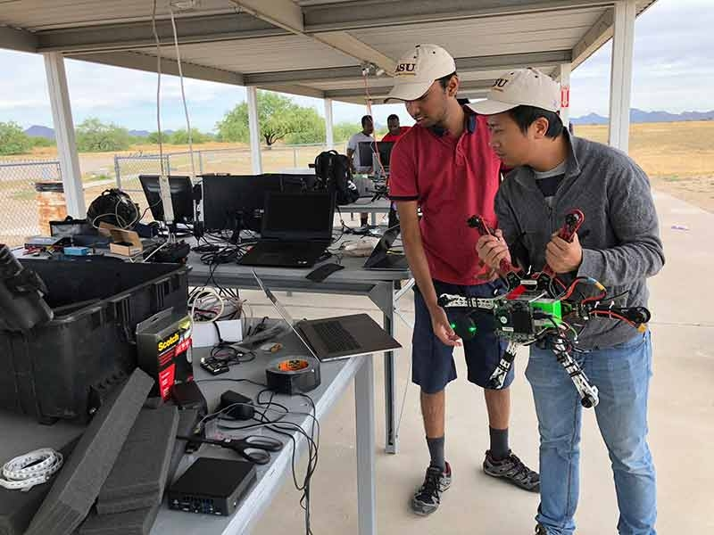 ASU students calibrate a drone at a 2019 competition