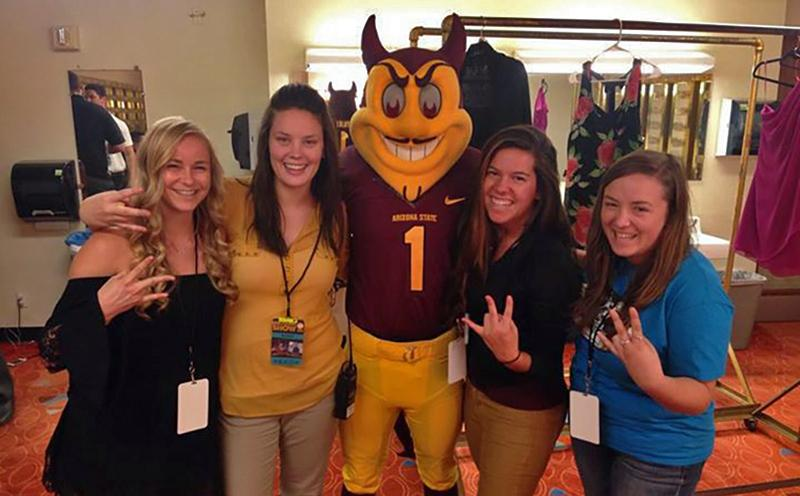 Photo of Lichterman and classmates celebrating the planning of ASU's 2014 Homecoming Dance