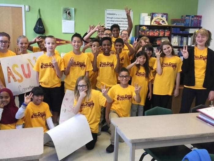 students in a classroom wearing ASU shirts