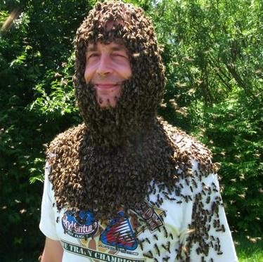 A man wears a beard made of bees