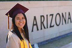 woman posing in graduation cap