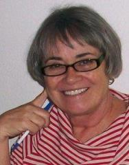 Woman in red striped shirt and glasses