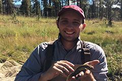 man holding lizard