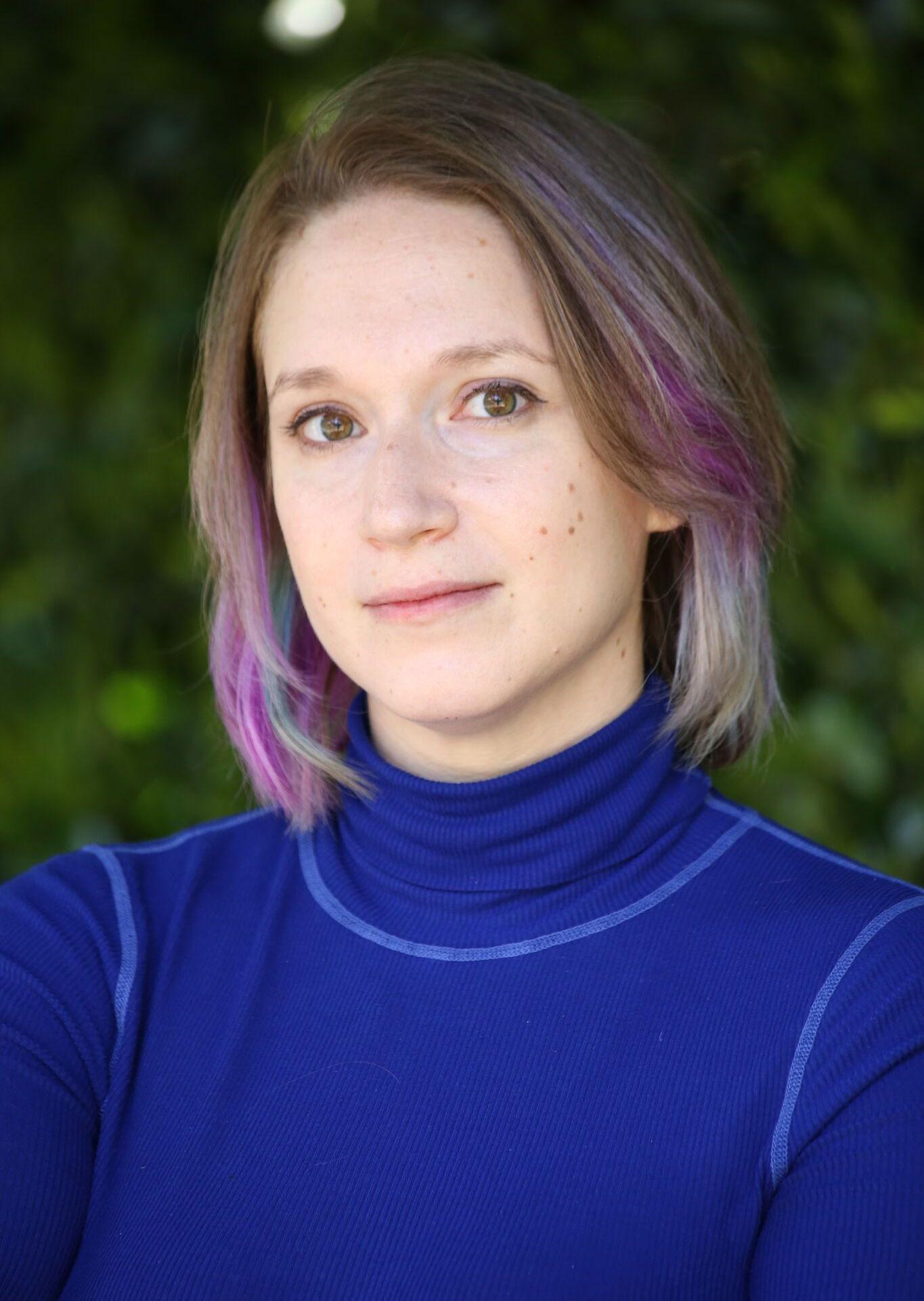 Woman in blue turtleneck