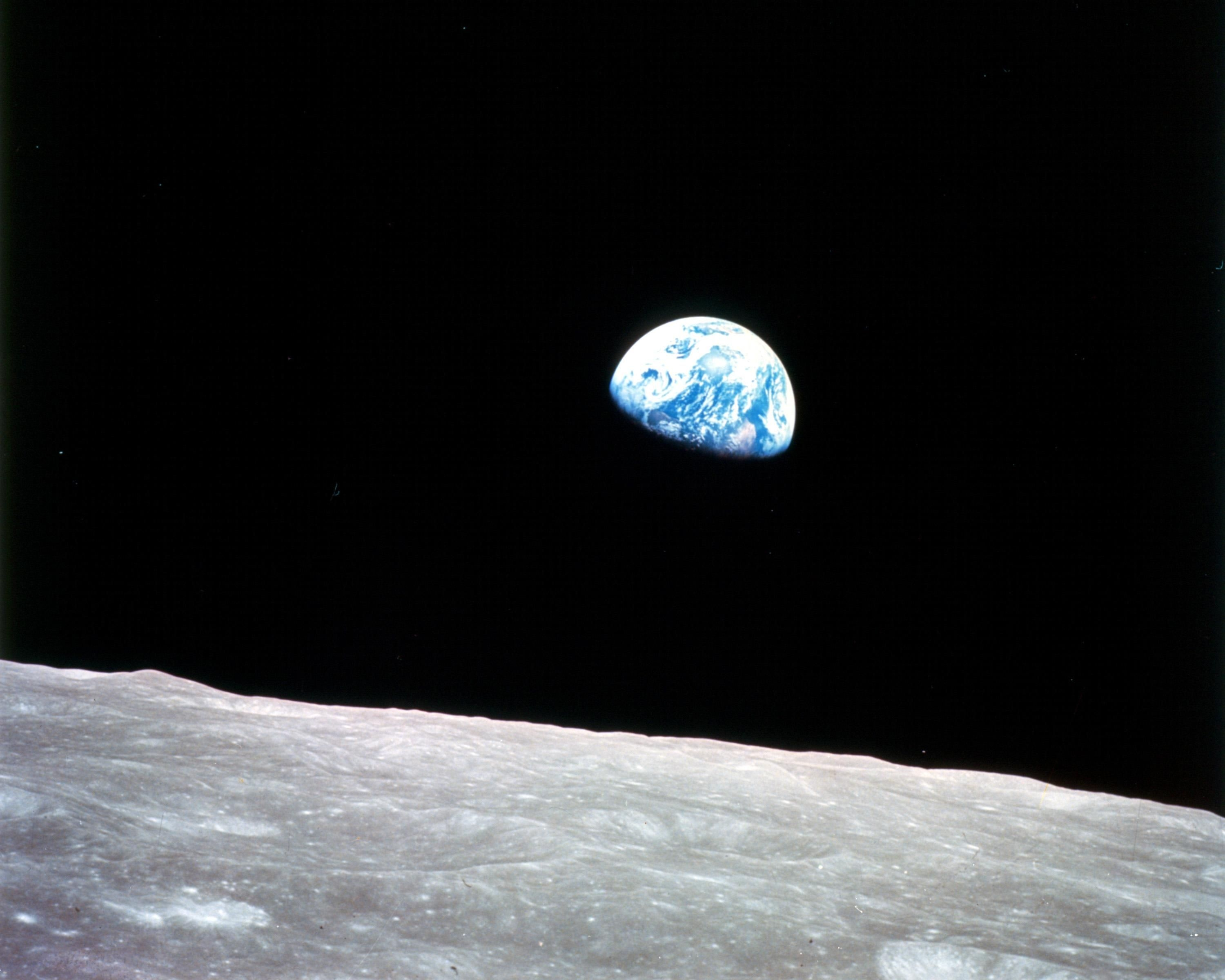 "The famous ""Earthrise"" photo, taken on the first manned mission to the moon."