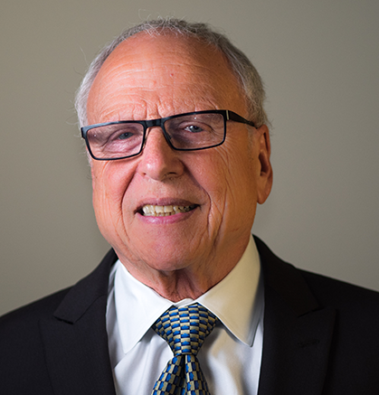 Man in glasses and suit and tie