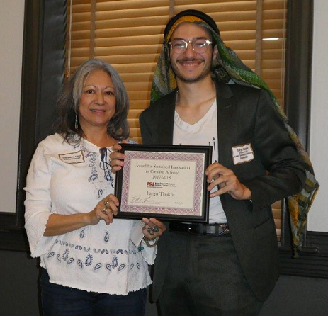 student and professor holding an award