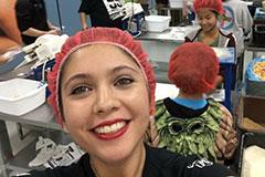 student volunteering with Feed my Starving Children