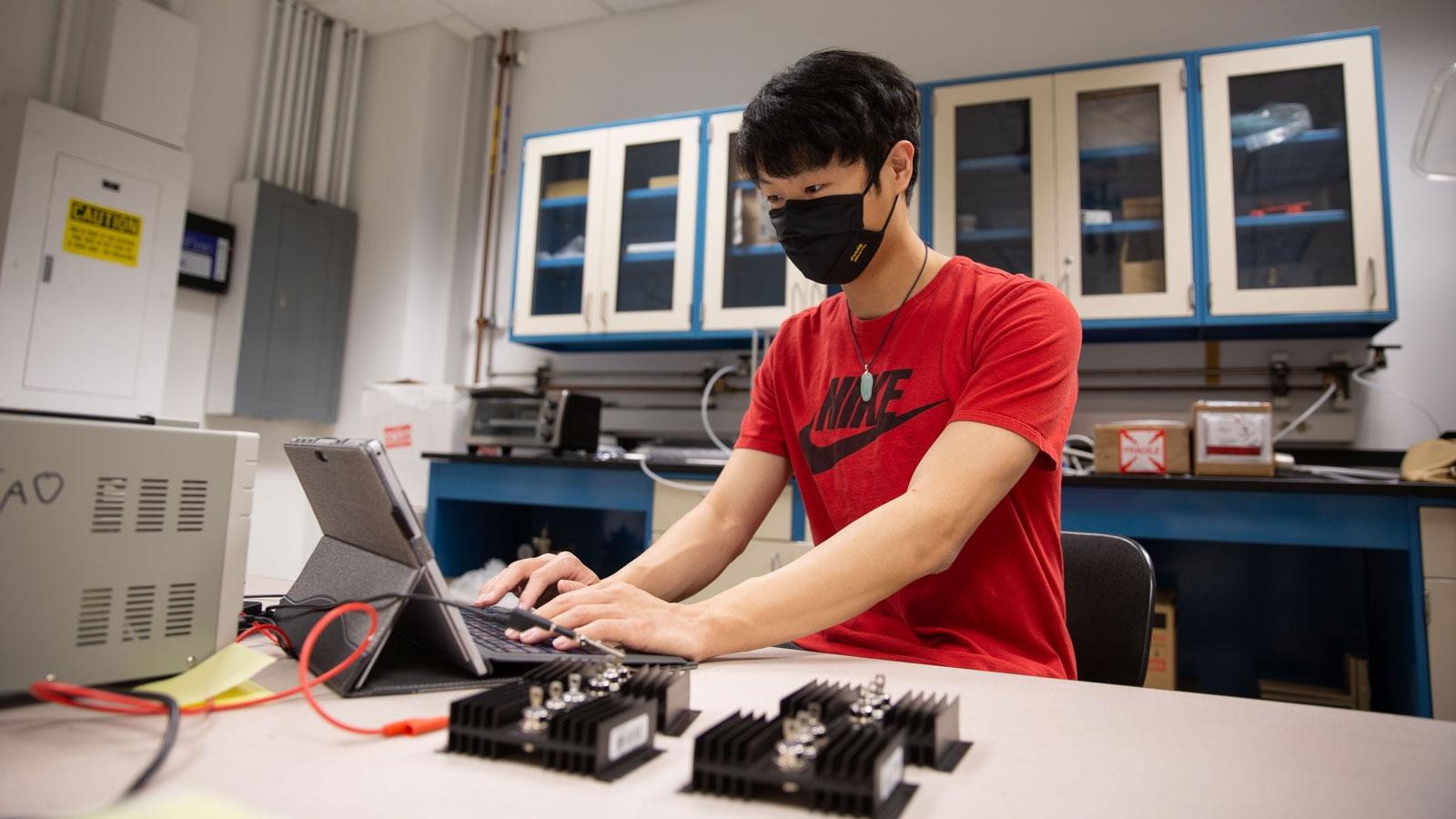 Kelvin Tan works in the lab