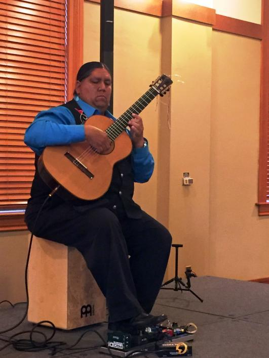 Classical guitarist Gabriel Ayala plays at the RED INK Sustainability Dinner on April 22, 2017. / Photo by Henry Quintero
