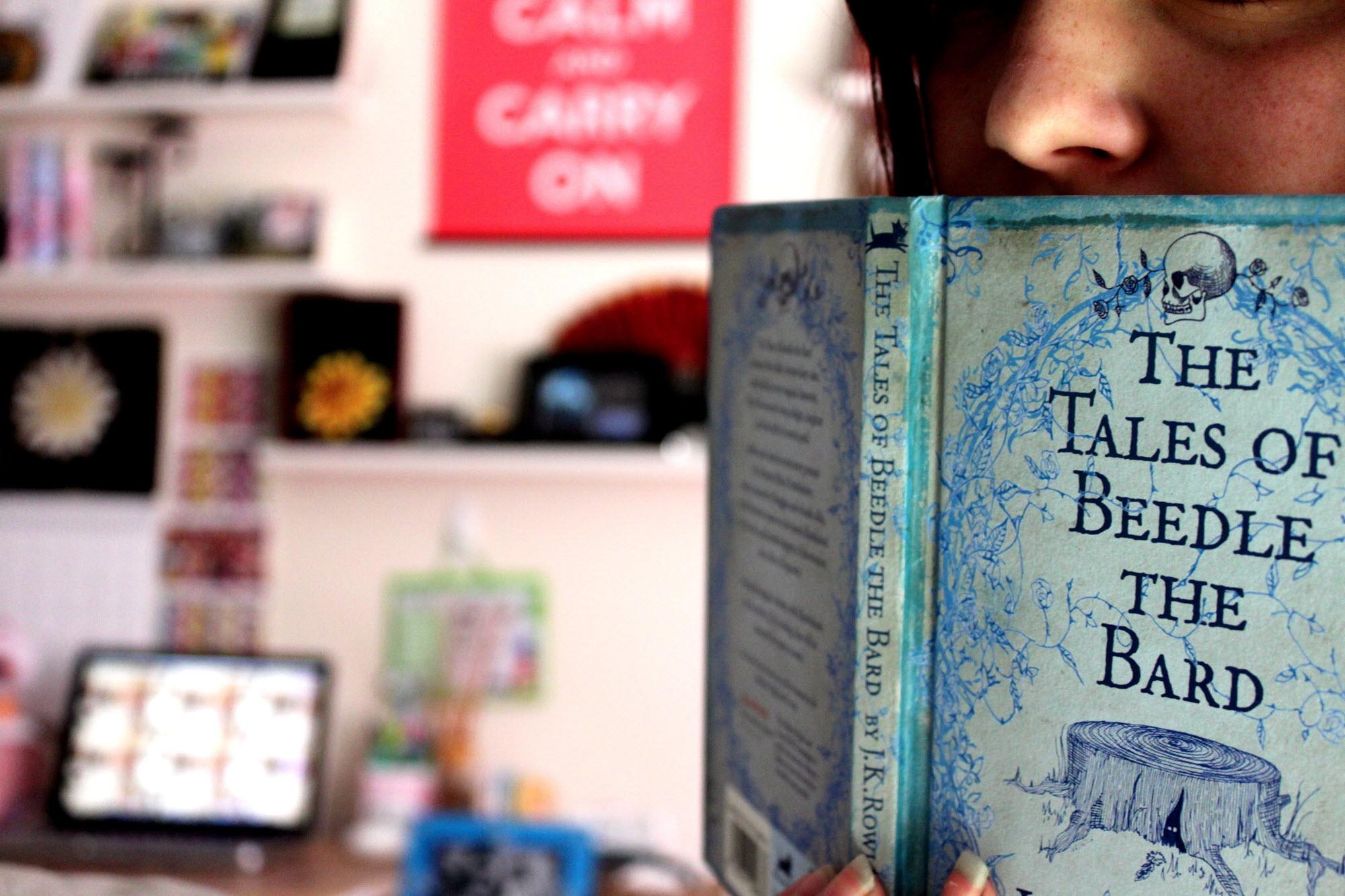 Girl reading J.K. Rowling novel / Photo by Lozikiki on Flickr
