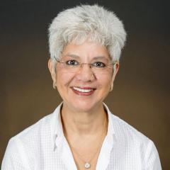Woman with gray hair and glasses