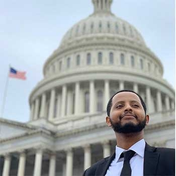 A man poses in front of the US Capitol in Washington DC