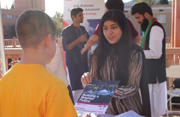 Farah Akram explains to members of the public what USAID's mission is in Pakistan at Tempe Night of the Open Door. Photographer Erika Gronek/ASU