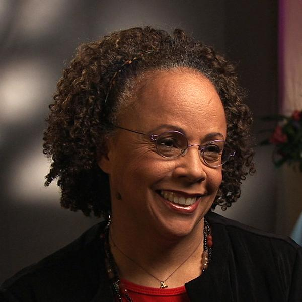 Woman in black coat smiling