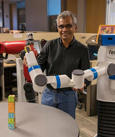 Arizona State University Professor Subbarao Kambhampati in his robotics lab