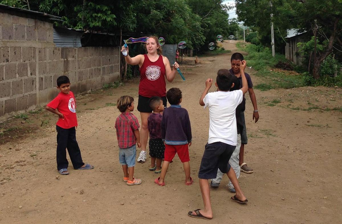 Kourtney Conn plays with kids in Nicaragua