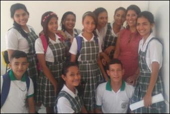 Larissa with several Colombian students in their school uniforms.