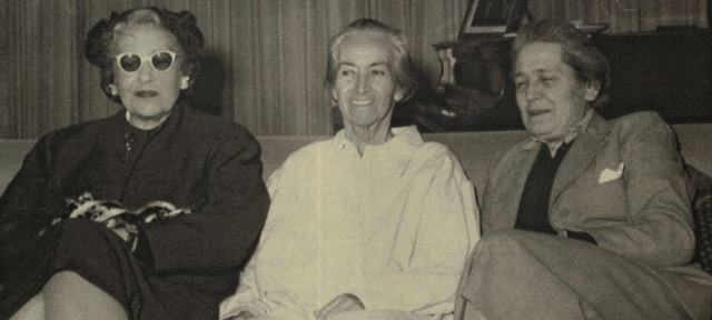 Chilean poet-diplomat Gabriela Mistral, Spanish lawyer and politician Victoria Kent and Argentine writer and intellectual Victoria Ocampo sitting on a couch
