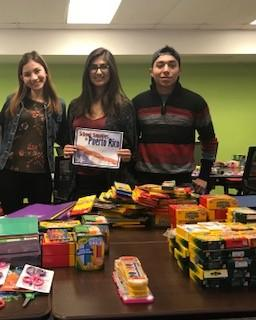 ASU students holding donated school supplies