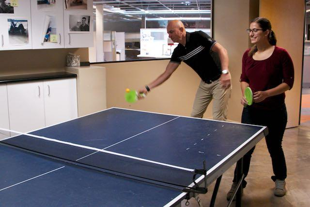 Steve Schramm and Stephanie Taylor compete in ping pong