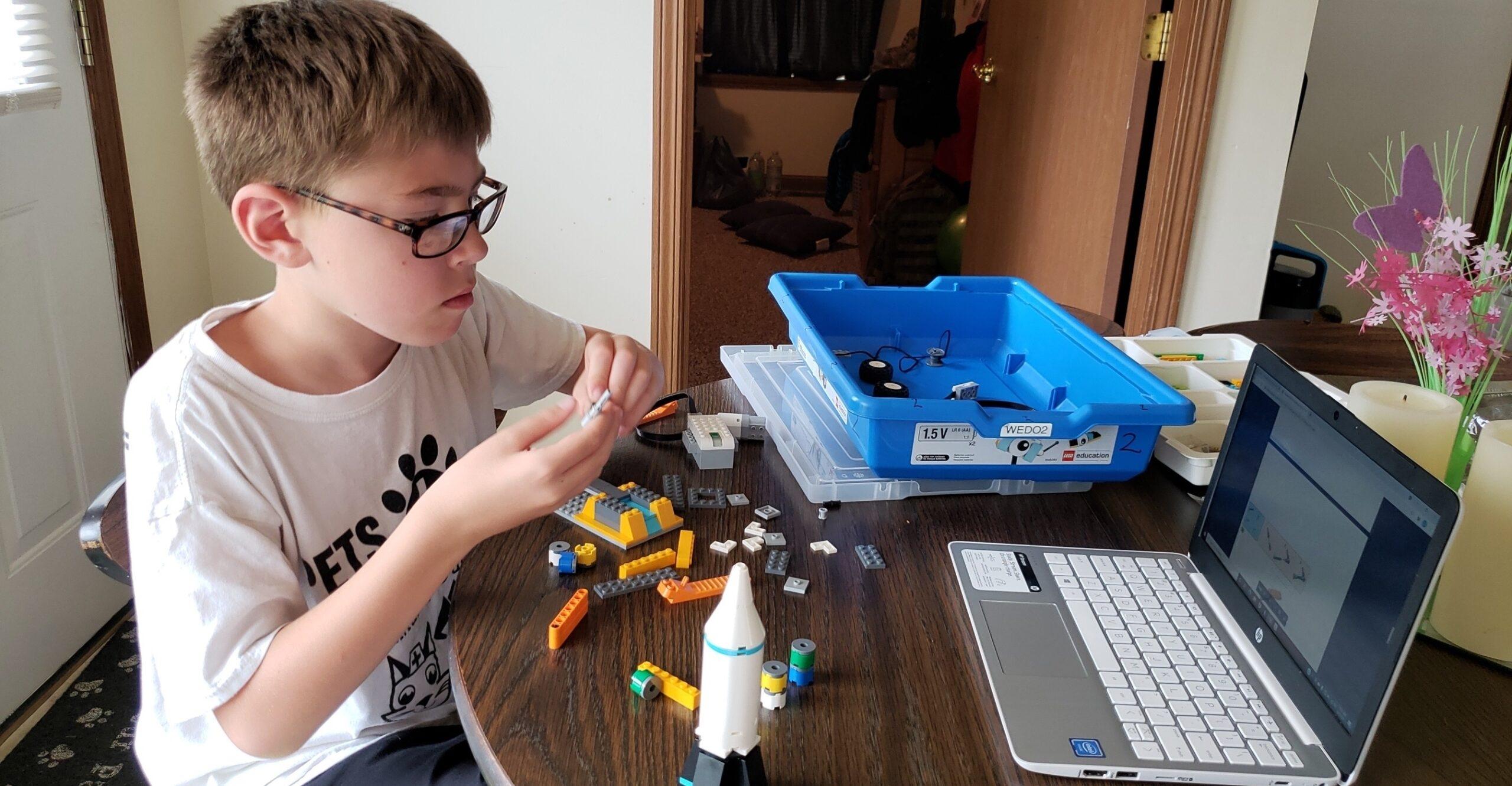 Fulton Academy camper building a LEGO Robot