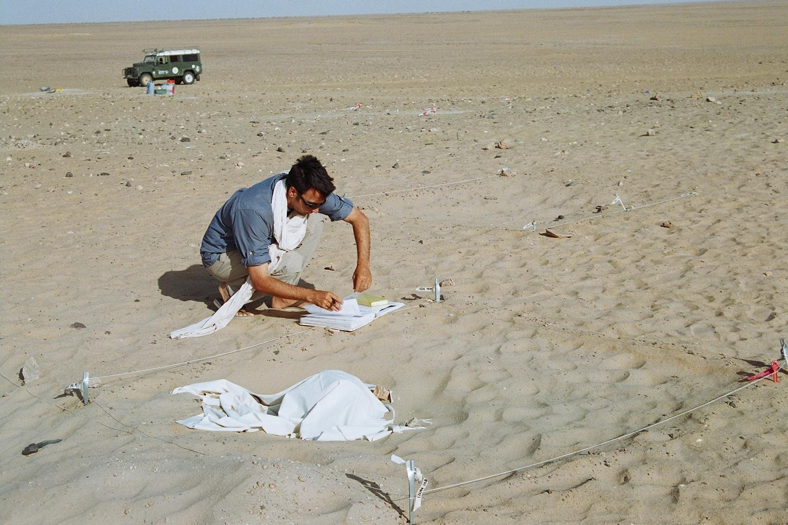 Photo of Stojanowski taking notes at his field site