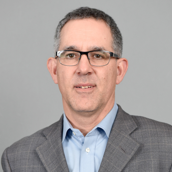 Man in glasses and tweed jacket