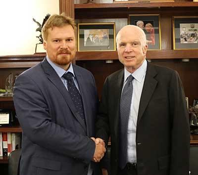 ASU McCain scholar Yaroslav Bekish shakes hands with Sen. John McCain