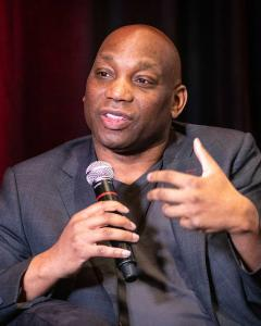 Author, writer and commentator  speaks onstage at the Global Sport Summit