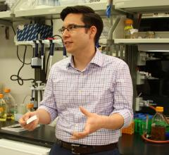 ASU professor Alexander Green talks in a Biodesign lab.